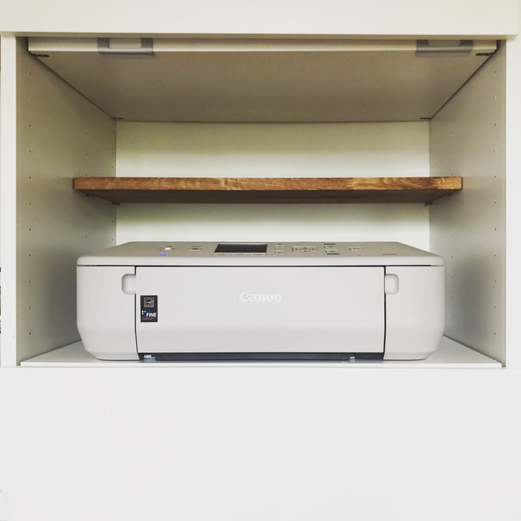 less consumption: printer on an otherwise empty shelf